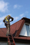 Construction worker on a roof Royalty Free Stock Images