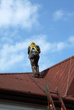 Construction worker on a roof Stock Image