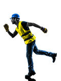 Construction worker running safety vest silhouette. One construction worker running with safety vest silhouette isolated in white background Stock Images