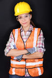 Construction worker with safety gear on black royalty free stock photography