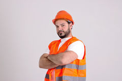 Construction Worker in Safety Helmet. Young Construction Worker in Safety Helmet and Orange Jerkin Isolated on White Background Stock Photo
