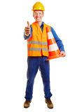 Construction worker with a safety vest and a helmet. Holding thumbs up Royalty Free Stock Photos