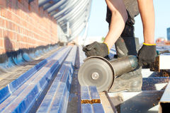 Construction worker sawing steel sheet Royalty Free Stock Image