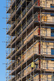Construction worker on scaffold Stock Photos