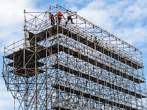Construction worker on a scaffold Stock Photography