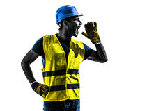 Construction worker screaming safety vest silhouette. One construction worker screaming with safety vest silhouette isolated in white background Royalty Free Stock Photography
