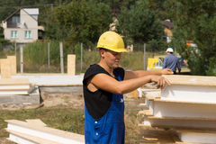 Construction worker selecting an insulation panel Royalty Free Stock Photo