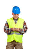 Construction worker sending sms Royalty Free Stock Photo