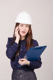 Construction worker shocked by what he heard on phone Stock Images