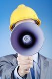 Construction worker shouting. Via loudspeaker Stock Image
