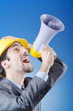 Construction worker shouting with loudspeaker. Construction worker shouting via loudspeaker Royalty Free Stock Photo
