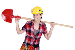 Construction worker with a shovel. Female construction worker with a shovel Royalty Free Stock Image