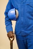 Construction worker with shovel and hard hat Royalty Free Stock Photo