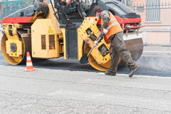 Construction worker with shovel. Urban road under construction. stock photo