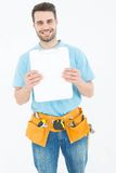 Construction worker showing blank paper on clipboard Stock Photography