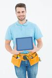 Construction worker showing blank screen on digital tablet Royalty Free Stock Photography