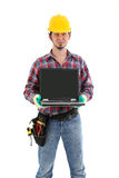 Construction Worker showing Laptop. On the white background. Isolated on white royalty free stock photos