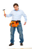Construction worker showing monkey with hammer. Unskillful tool treatmant concept Stock Image