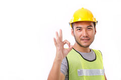 Construction worker showing ok hand sign gesture Stock Images
