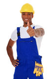 Construction worker showing thumbs up. Portrait of an attractive black construction worker showing thumbs up. All on white background Stock Photo