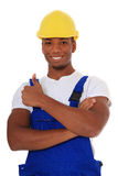 Construction worker showing thumbs up. Portrait of an attractive black construction worker showing thumbs up. All on white background Stock Image