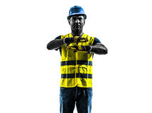 Construction worker signaling safety vest emergency stop silhoue Stock Photography
