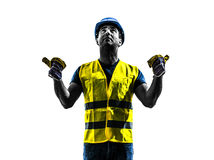 Construction worker signaling safety vest extend boom silhouette. One construction worker signaling with safety vest extend boom silhouette isolated in white Royalty Free Stock Image