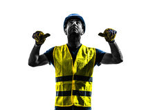 Construction worker signaling safety vest retract boom silhouett. One construction worker signaling with safety vest retract boom silhouette isolated in white Royalty Free Stock Photography