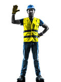Construction worker signaling safety vest silhouette. One construction worker signaling with safety vest silhouette isolated in white background Stock Photography