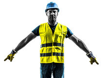 Construction worker signaling safety vest silhouette. One construction worker signaling with safety vest silhouette isolated in white background Royalty Free Stock Photo