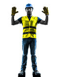 Construction worker signaling stop gesture silhoue Stock Photography