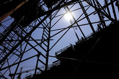 Construction worker silhouette on scaffold Stock Photo