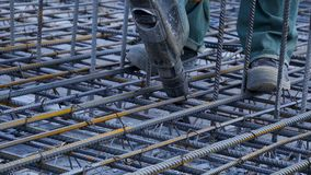 Construction worker. Worker in the construction site making reinforcement metal framework for concrete pouring Royalty Free Stock Image