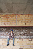 Construction Worker Sitting On Brick Wall Royalty Free Stock Photo