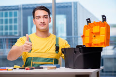The construction worker sitting at the desk Stock Images