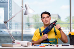 The construction worker sitting at the desk Royalty Free Stock Photos