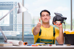 The construction worker sitting at the desk Stock Photos
