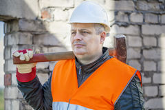 Construction worker with sledge hammer Royalty Free Stock Images