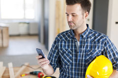Construction worker with smart phone Royalty Free Stock Image