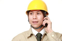 Construction worker with smart phone Stock Images