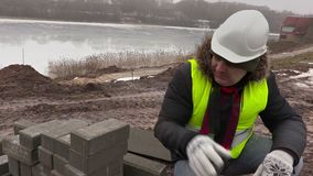 Construction worker sorting pavement close up stock footage