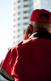 Construction worker speaking on cellphone Stock Image