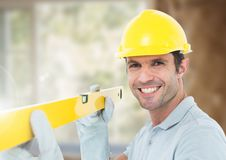 Construction Worker with spirit level in front of construction site Royalty Free Stock Images