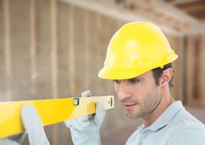 Construction Worker with spirit level in front of construction site Stock Photography