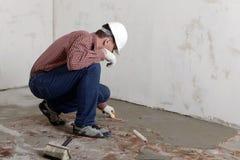 Construction worker spreading concrete Stock Photo