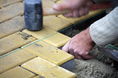 Construction worker spreading slab floor Stock Image