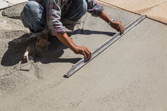 Construction worker spreading wet concrete Royalty Free Stock Images