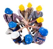 Construction worker stacking hands. Large group of construction worker stacking hands. Isolated on white Royalty Free Stock Photos