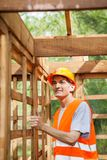 Construction Worker Standing In Incomplete Wooden Royalty Free Stock Image