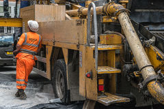 Construction worker. Standing near the truck and looking up Royalty Free Stock Photos